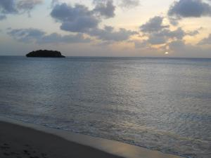 Sunsets in St. Lucia, photo taken from our beach with 'Shell Island' pictured